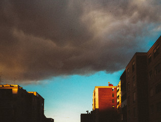 View of storm clouds over city