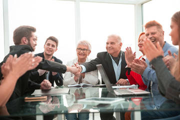 businessmen shaking hands in a meeting at office