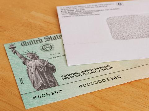 ATLANTA, GEORGIA - May 7, 2020 : United States Treasury Economic Impact check including President Donald J. Trump printed name. Stimulus check for Coronavirus COVID-19 pandemic relief.