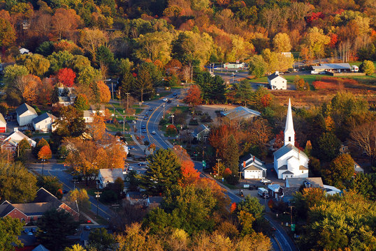 Autumn foliage surrounds a quaint New England town