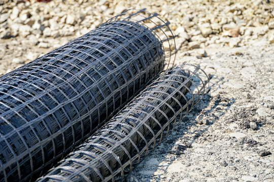 geogrid rolled into a roll, material for road surface repair