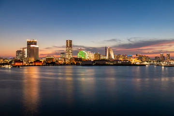 Fototapeta Minato Mirai skyline during the sunset with the reflection in the sea. Long exposure.