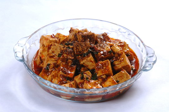 Close up of popular Chinese dish from the Sichuan province Mapo tofu in glass dish (Chinese: Mapodoufu)