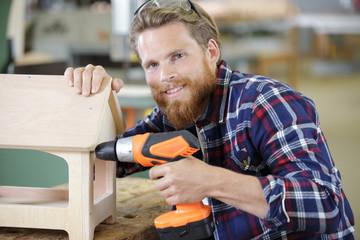 young carpenter making a bird house