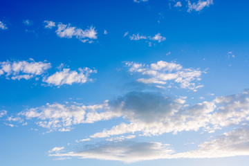 Blue sky with floating white clouds. The background.