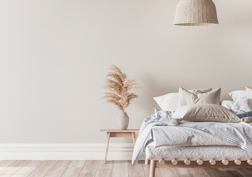 Home bedroom interior mockup with a wooden bed, beige and blue bedding, pillows, a vase of pampas and rattan lamp on empty wall background, 3d render