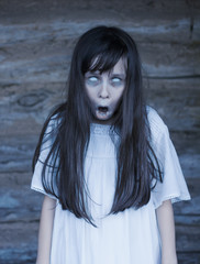 Photo sur Plexiglas Doux monstres Scary ghost halloween theme. Horror devil girl with white eyes opens mouth and shouts