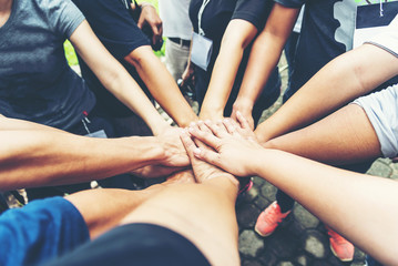 Solidarity unite people hands together community teamwork. Hands of spirit team working together outdoor. Unity strong handshake with people or agreement of feeling or happy diverse education action