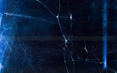 Ice abstract background. Cracked texture. Blue frozen water surface with dust scratches.