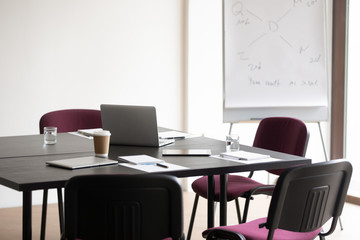 Time-out in strategy planning. Empty boardroom with conference table and comfortable chairs...