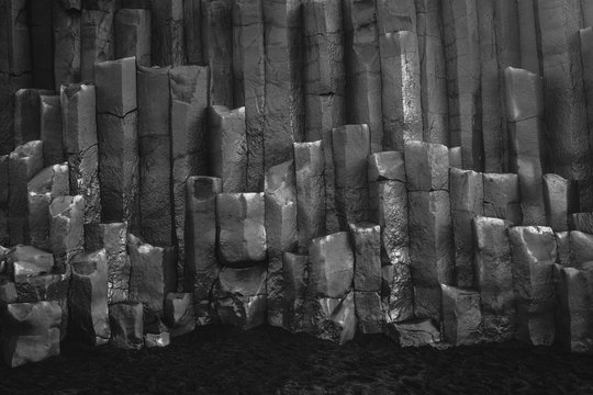 Grayscale shot of basalt columns