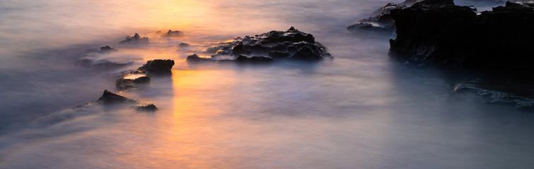 beautiful long exposure of a rocky beach at sunset, Mallorca, Spain