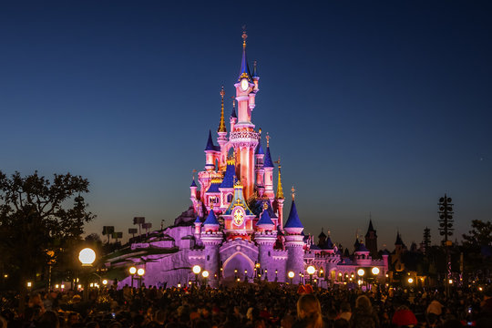 Night performance near Sleeping Beauty castle in Disneyland Paris. Disneyland Paris (Euro Disney Resort) - entertainment resort in Marne-la-Vallee. Marne-la-Vallee, France. March 30, 2019.