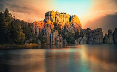 Fantastic Sunrise over Sylvan Lake, South Dakota in Custer State Park. The unique rock formation reflected in the lake