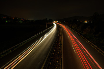 Car light trails on a highway in night