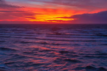 Wall Murals Crimson Glowing orange sunset at the seaside