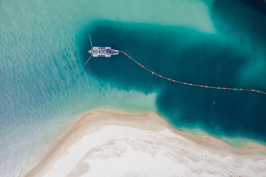 Burleigh Heads National Park aerial image with Tallebudgera creek and sand pumping/dredging boat