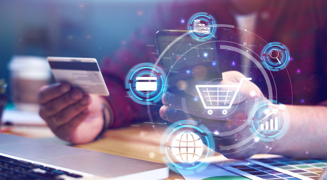 Futuristic business concept businessman using Credit card verifies account balance on mobile phone banking application. Online payment shopping, selective focus, accessible internet money transaction