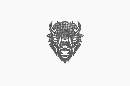 Silhouette of head of wild buffalo or bison as symbol of nature exploration hand drawn stamp effect vector illustration.