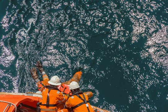 Marine crews of a pipelay barge performing man overboard emergency rescue drill at Kemaman Port Anchorage