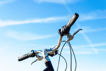 Bicycle handlebar on blue sky background