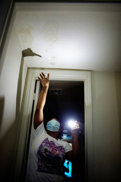 Brandie Barrow points to mold in the ceiling of an apartment where she was living in Algiers, in New Orleans