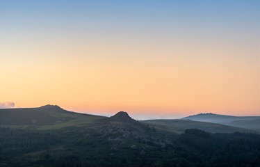 Absolutely stunning landscape image of Dartmoor in England showing Leather Tor, Sharpitor and Kings Tor in majestic sunrise light