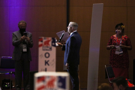 Delegates begin to cast their votes in the Charlotte Convention Center's Richardson Ballroom in Charlotte, during the roll call to renominate Donald J. Trump to be President of the United States and Mike Pence to be Vice President is opened, in Charlotte