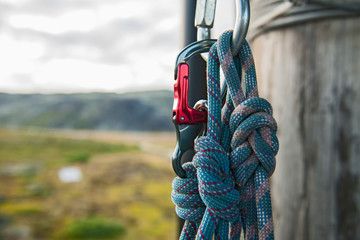 close up of carabiner and rope at high rope obstacle course