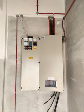 SELANGOR, MALAYSIA -AUGUST 19, 2020: Electrical distribution board in the installation process. Electrical wireman will install this equipment according to the electrical engineer design.