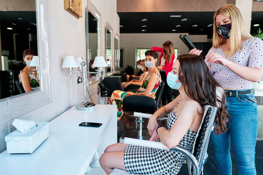 group of female clients with social distance and face mask at a hair salon