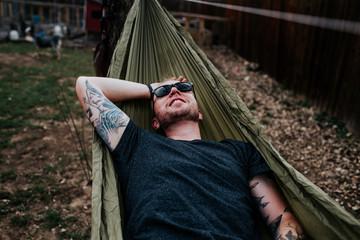 Happy Man relaxing in hammock