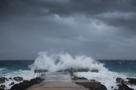 A dock getting pounded by Hurricane Laura as she lands on Grand Cayman