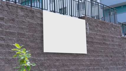 empty advertise placard with white place for mock up hanging on brick wall