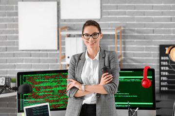 Portrait of female programmer in office