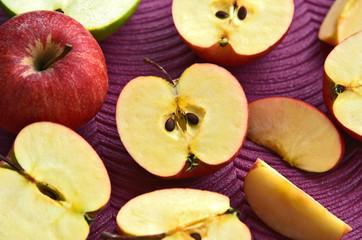 Fototapeta Many sliced red Gala apples on purple background. obraz