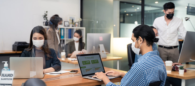 Asian business people working in office with new normal lifestyle.