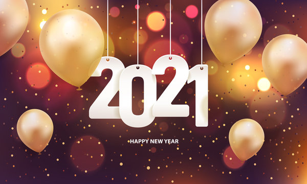 Happy new year 2021. Hanging white paper number with gold balloons and confetti on a colorful blurry background.