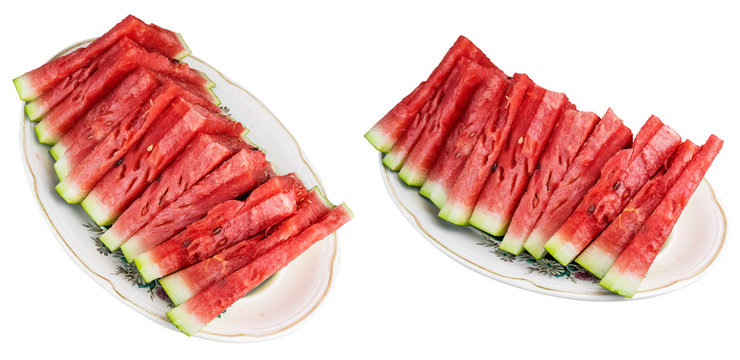 The sliced watermelon lies on an oval plate. Isolated