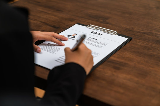 Businesswoman fill resume application information on the desk, presents the ability for the company to agree with the position of the job.