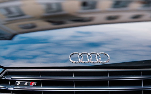 Minsk, Belarus. Jun 2020. Logo of Audi company on Audi TT RS sports car standing on the street. Element of front grille and hood of Audi RS with symbols. Body exterior
