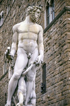 Magnificent Neptune sculpture in city center square in Florence