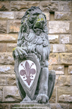 Magnificent symbolic lion sculpture with lily flower in Florence