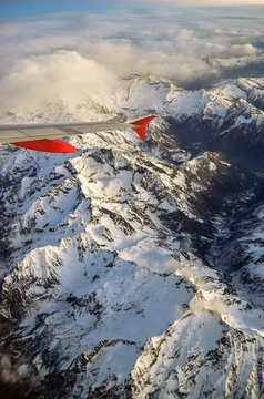 Beautifull snowy mountains view from airplane window