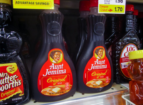 ATLANTA, GEORGIA - June 30, 2020 : Aunt Jemima pancake syrup bottles on local grocery store shelf.
