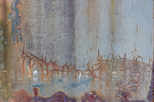 decayed rusty metal plate