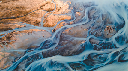 A glacial rivers from above. Aerial photograph of the river streams from Icelandic glaciers....