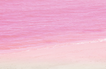 Sea water and pink sand background