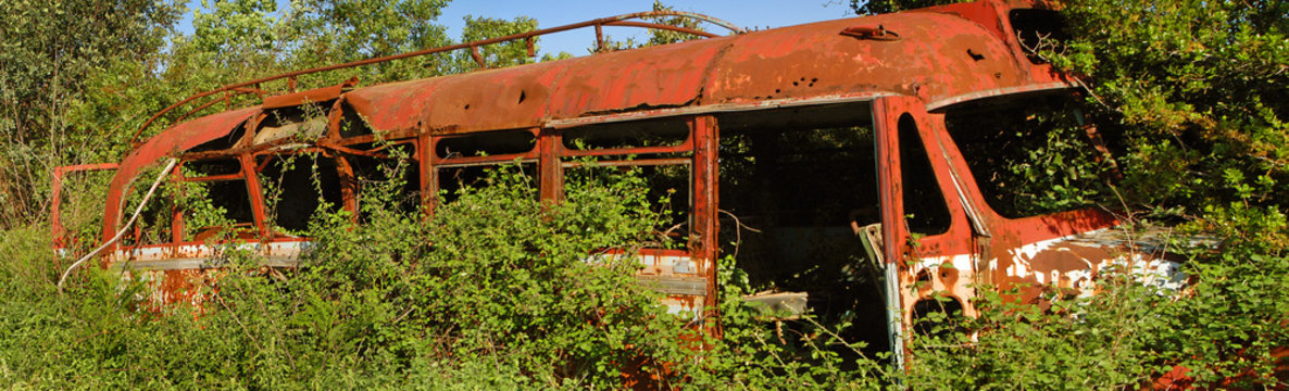 Abandoned old rusty school bus