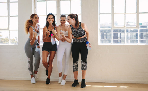 Happy fitness women at the gym